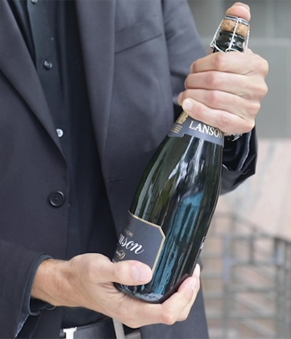 opening lanson champagne bottle