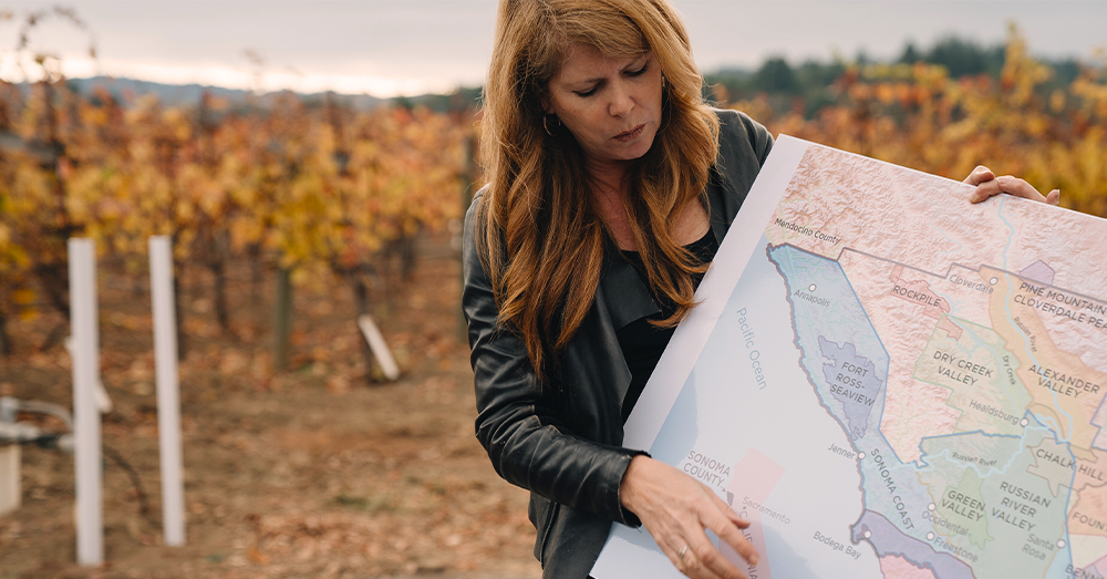 Ondine Chattan, winemaker looking at map.