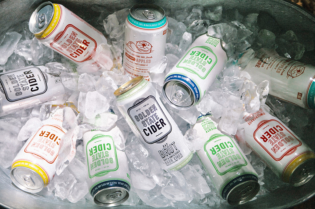 Golden State cider cans in ice